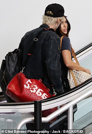 Moving on: The two hopped on an escalator together