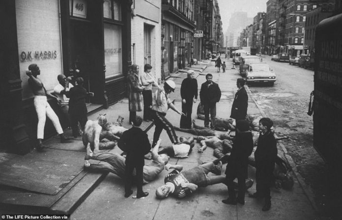 Above, sculptor Duane Hanson with blond hair standing with life-size fiberglass models of winos, cops, soldiers and demonstrators in front of Soho art gallery in the 1980s