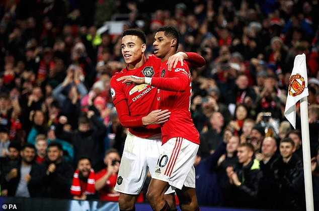 Greenwood's goal means he has more United goals than Marcus Rashford (right) did at 19