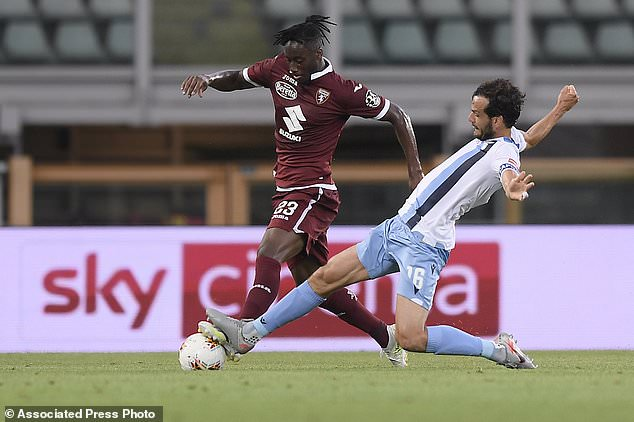 Torino's Soualiho Meite is tackled by Lazio's Marco Parolo during the Italian Serie A soccer match between Torino and Lazio at the Olimpico Grande Torino stadium in Turin, Italy Tuesday, June 30, 2020. (Fabio Ferrari/LaPresse via AP)