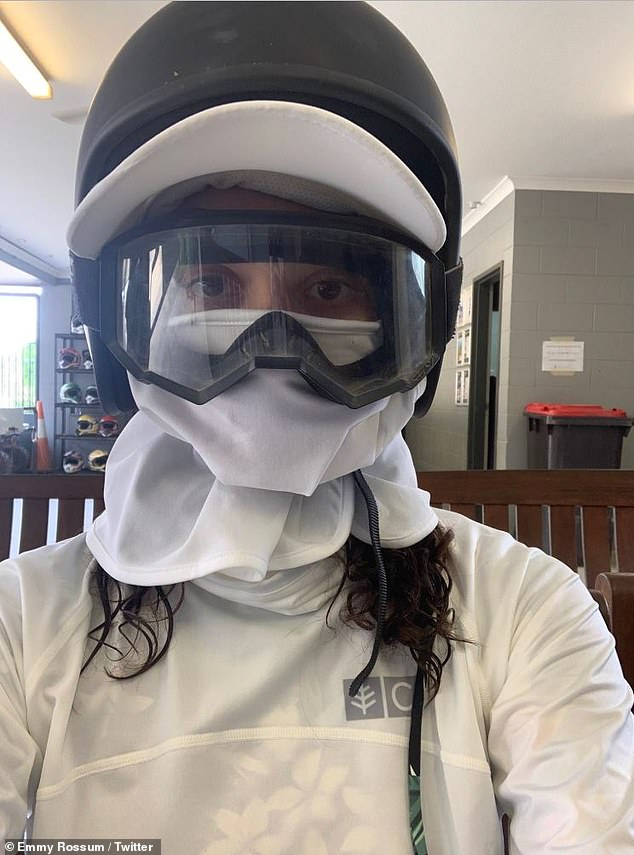 Ahead of the curve:After a fan commented on Tuesday that an old tweet from Emmy Rossum 'did not age well,' as she wore protective gear months before the pandemic, she used the opportunity to tell fans to follow guidelines and wear masks in public