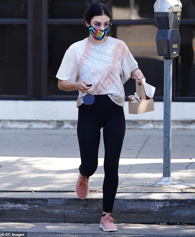 Mask on: Lucy wore a multi-colored mask amid the coronavirus pandemic