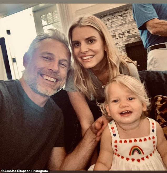 Beaming: The actress posed with her husband Eric Johnson, 40, and daughter Birdie, one