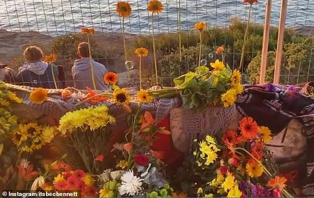 Undeterred by the temporary fence around the WWII bunker, Ms Bennett and friends climbed into the area at North Head to lay flowers