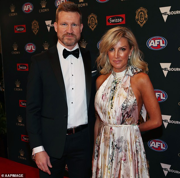 Collingwood coach Nathan Buckley (pictured with wife Tanya) admitted Sidebottom had been 'confused' about exactly what occurred. He said he expects him to be banned for several weeks