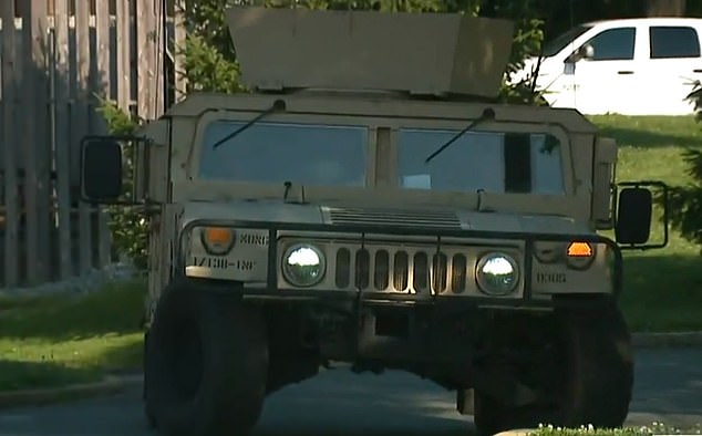 The armored vehicle parked outside the Florissant Police Department