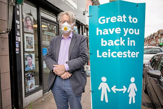Pictured: Robert Hardman stands by a sign reading 'great to have you back in Leicester' as the city's lockdown is extended