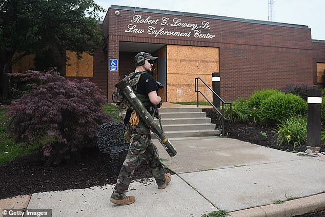 The man was armed with a bazooka as he joined a group calling themselves the People's Protection Groups at demonstrations in Florissant, Missouri, on Tuesday