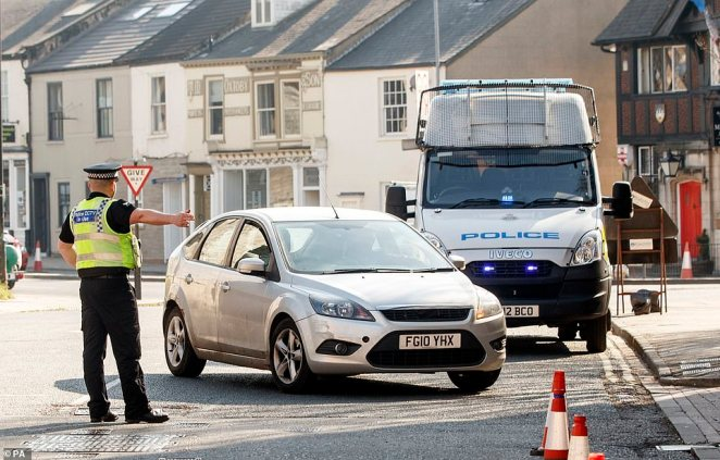 Police check cars in York on March 26. Officers will perform similar checks to ensure locals are obeying the new locdkown in Leicester
