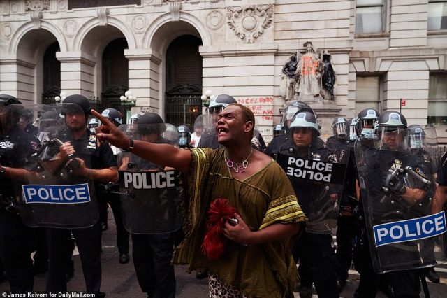 The protester was distraught as they got off the ground and screamed while the officers stood behind them