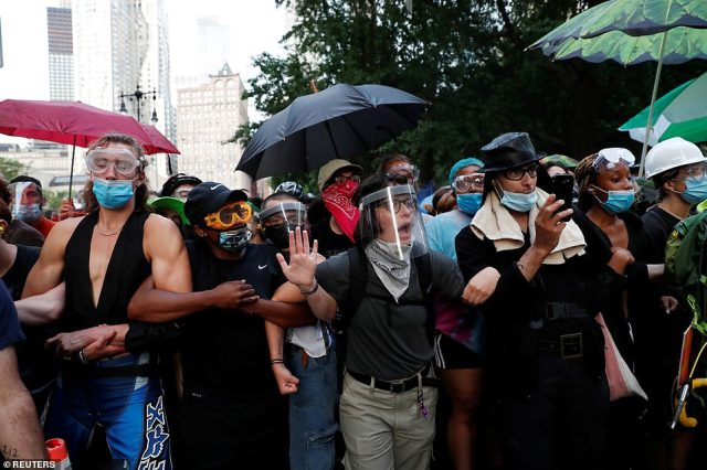 The protesters linked arms to defend themselves from the police. Many wore shields or masks to protect themselves and others from coronavirus