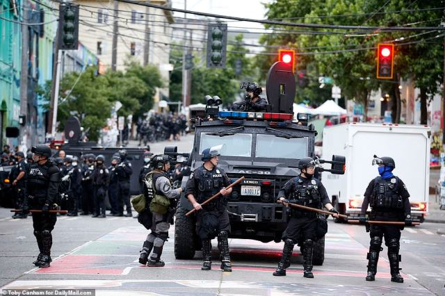 Seattle police on Wednesday moved in to reclaim their precinct in the city's 'occupied' protest zone