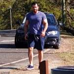 Musclebound man, 29, charged with slashing a woman with an axe then trying to bundle her into a car