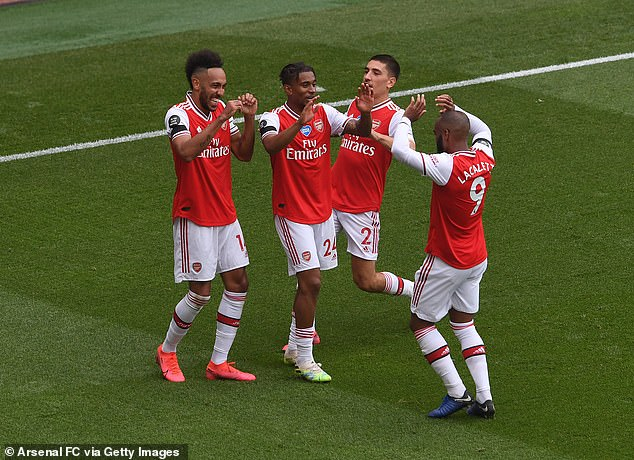 Bellerin and his team-mates celebrate during Wednesday's 4-0 thrashing of Norwich City