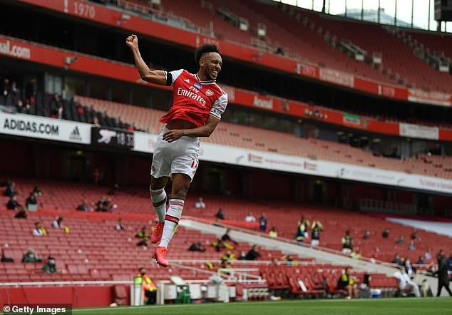 Aubameyang celebrates after scoring the first of his two goals against the struggling Canaries