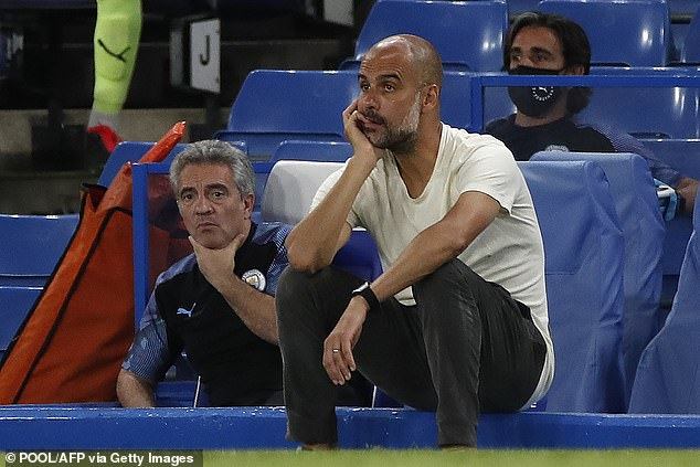 Guardiola looks on as City are beaten at Chelsea last week - handing the title to Liverpool