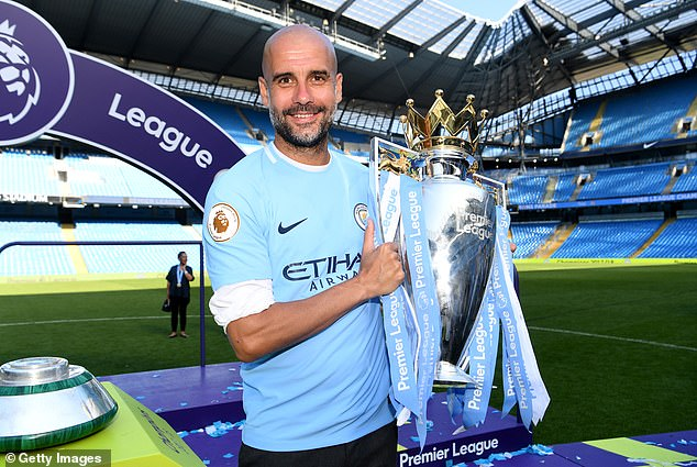Guardiola with the Premier League title in 2018 - when City amassed 100 points