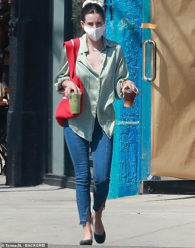 Sleek and chic: The 28-year-old daughter of Bruce Willis and Demi Moore slipped into a fashionable pale green blouse and skintight jeans for her outing