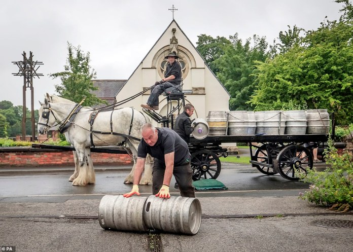 Pub fans across England are expected to receive showers on Saturday while parts of the hospitality industry are expected to reopen. Pictured: Samuel Smith's brewery in Tadcaster delivers beer to local pubs by horse cart before Super Saturday