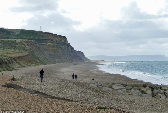 People enjoy the early morning weather at Hengistbury Head in Dorset before the washout this weekend