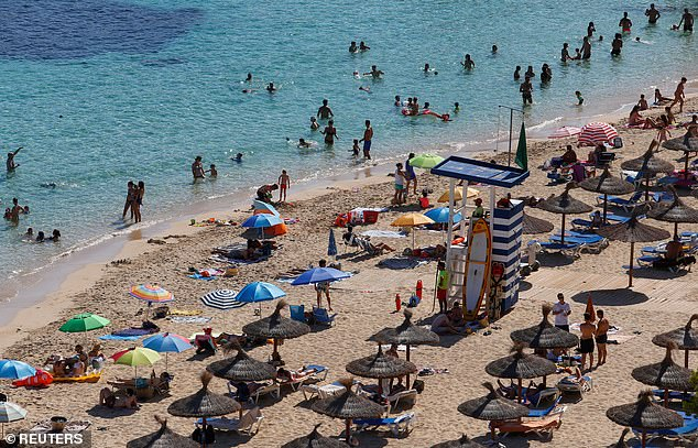 Holidaymakers return to Portals Nous in Mallorca yesterday as Spain starts to return to normal