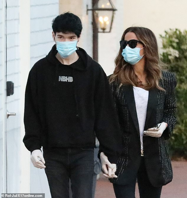 Faceless eyes: the pair wore protective masks as the COVID-19 pandemic raged