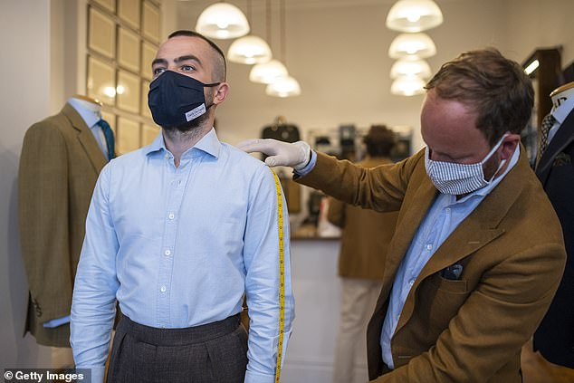 Some Savile Row stores (pictured, o Cad & The Dandy on June 15) have been serving customers during the lockdown while others are opening in the coming days