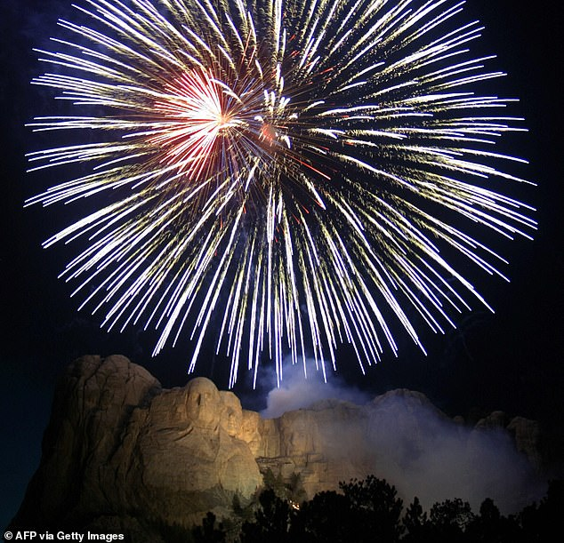 President Donald Trump is beginning Fourth of July weekend with a fireworks display at Mount Rushmore. Pictured: Fireworks over Mount Rushmore National Memorial, July 2004
