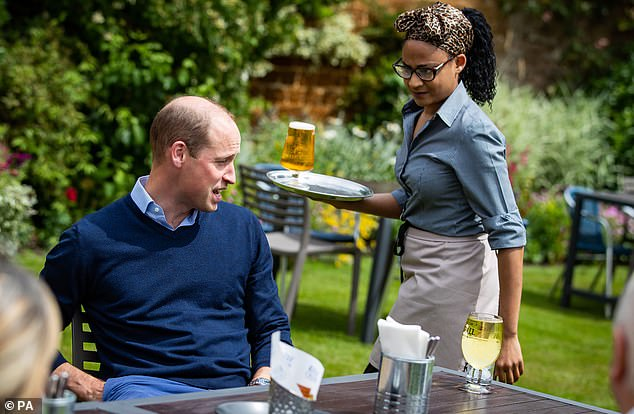 After being asked to cleanse his hands in sanitiser gel before ordering a pint at the bar, it was then delivered to him at a table in the garden (pictured)