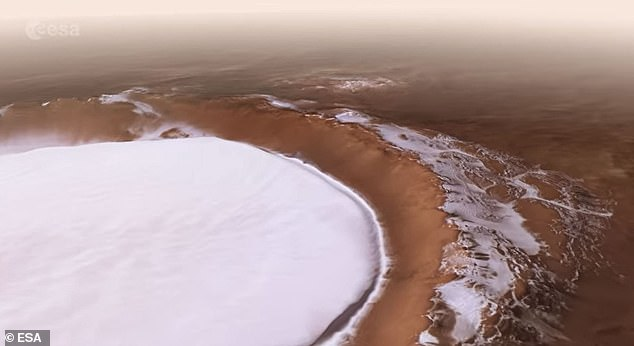 Located in the northern lowlands, the depression is 51 miles across, more than a mile deep and is coated in a layer of thick water ice. The visualization starts with a shot of Mars and then skates around Korolev for a spectacular view of the frozen cavern.