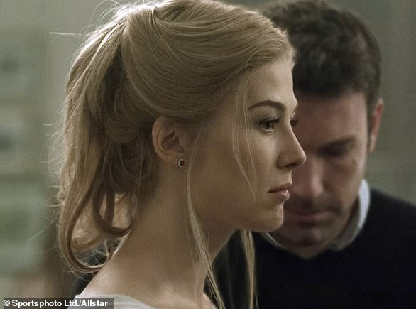 Depp's lawyer Adam Waldman sent an email to Heard's team which said: 'When we last met, you said Amber Heard would have to be 'Gone Girl' [film pictured above] for the abuse allegations to be false. One audio tape (plus a mountain of other evidence) has shown her to be so.'