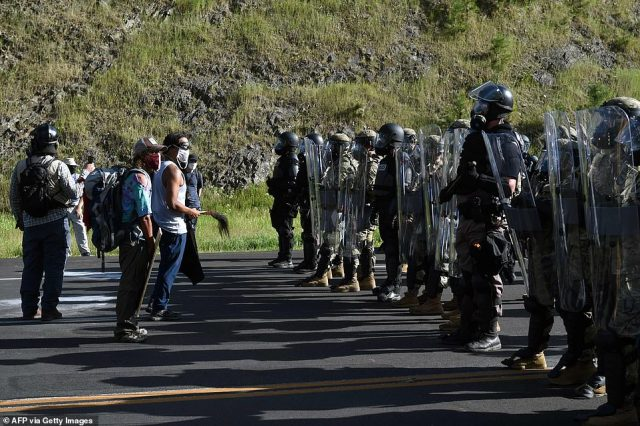 Cops in riot gear and military personnel moved in to try to disperse crowds
