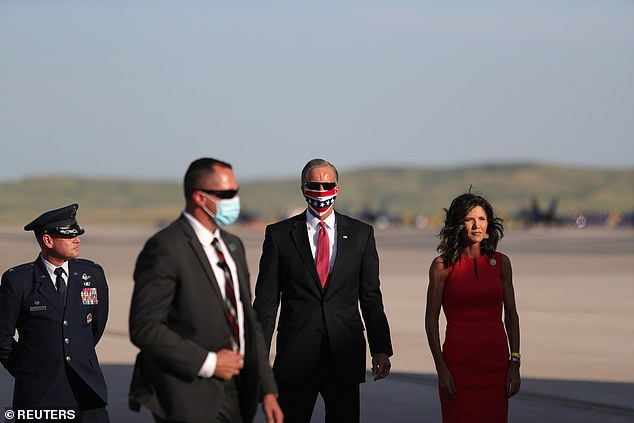 South Dakota Gov. Kristi Noem (right) greets the Trumps atEllsworth Air Force Base, South Dakota Friday night
