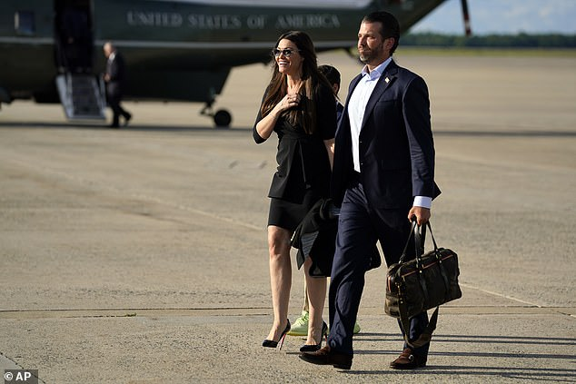 Donald Trump Jr., walks with Kimberly Guilfoyle after arriving at Andrews Air Force Base, Md., on May 27 after traveling to Florida with President Donald Trump