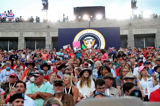 Attendees wait for U.S. President Donald Trump to speak at South Dakota's U.S. Independence Day Mount Rushmore fireworks celebrations