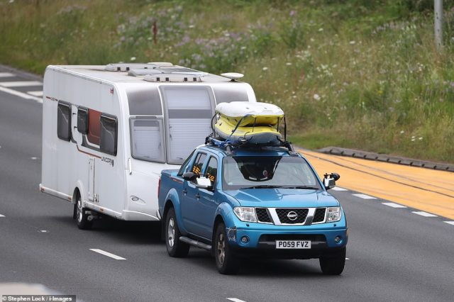 Traffic on the M25 motorway in Kent early this morning as hotels, restaurants and hotels re-open with people being able to stay overnight or longer in England as part of the next stage of the coronavirus lockdown easing