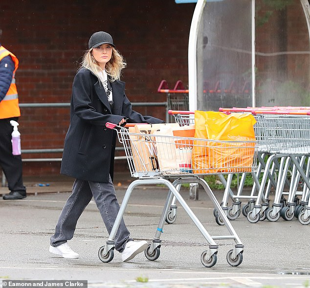 Outdoors: Perrie Edwards cut a laid-back figure that she pulled out with Alex Oxlade-Chamberlain Wendy's mother at a low-key supermarket in Wilmslow on Friday