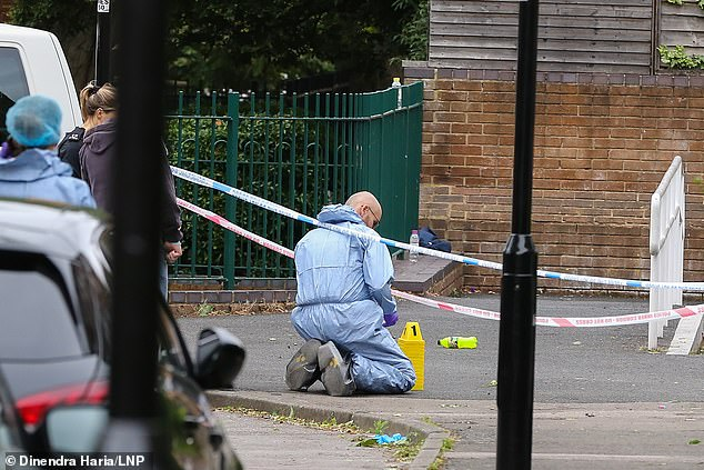 Scenes of crime officers have begun a forensic examination of the scene on Roman Way, Islington where a man in his 20s was shot dead earlier this afternoon
