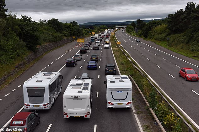 The M5 Exeter was swamped with camper vans and caravans heading to the coast at Junction 30 this morning, as tourists made their weekend getaway on what has been dubbed 'Super Saturday'