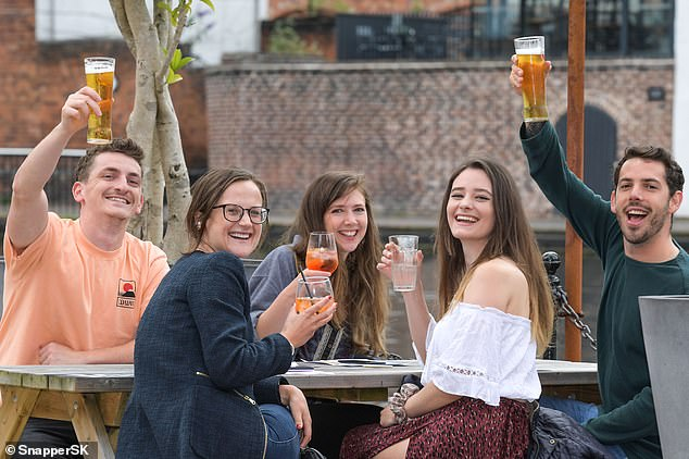 Pubgoers enjoyed a cold pint in the beer garden at the Canal house in Birmingham. The waterside location is large enough for several bubbles of friends to catch up and have a laugh on Super Saturday