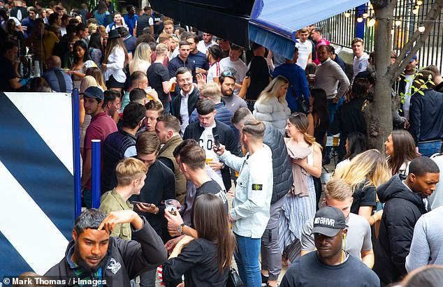 Scenes in London were in stark contrast to Leicester as dozens of revellers flocked to now-open pubs. Pictured: Borough Market in London, normally a busy hot-spot for food-lovers and those in search of a pint, was packed