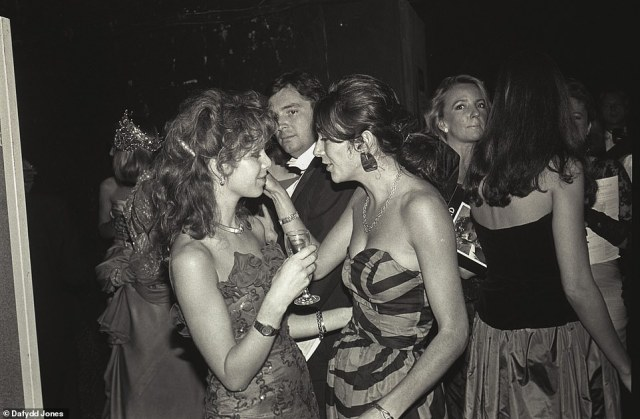 Society darling: Maxwell parties with friend Julia Verdin (pictured right) at the exclusive Boisdale Ball in 1986