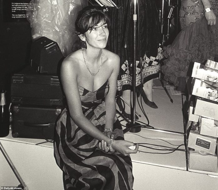Chic: Ghislaine Maxwell looking for a perfect image in a superb long dress while sitting on a stage in the 1980s in London