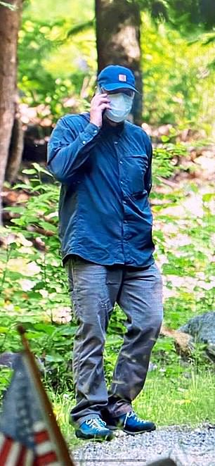 A mystery man is seen at the New Hampshire property Tuckedaway owned by Ghislaine Maxwell following her arrest on Thursday