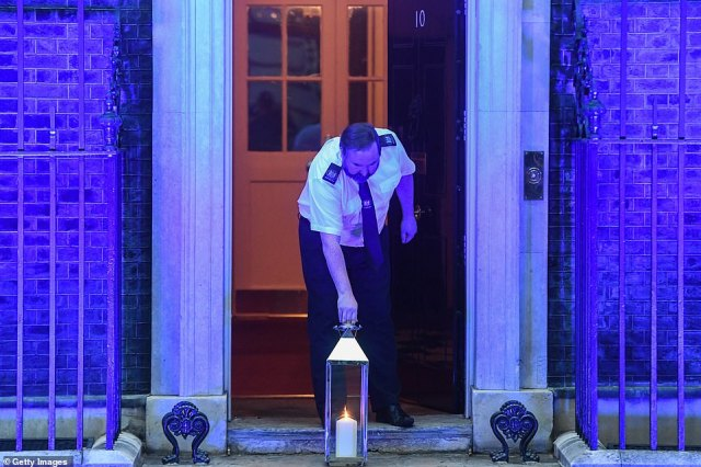 Prime Minister Boris Johnson was among those due to take part in country-wide event, with a candle lit at his official residence at 9pm on Saturday, ahead of the National Health Service's 72nd anniversary.Pictures showed a Downing Street worker bringing an pre-lit candle outside