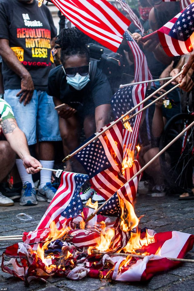 Several American flags were torched on Saturday as protesters lit them ablaze near Trump Tower in New York City as citizens are becoming increasingly exhausted by divisive rhetoric