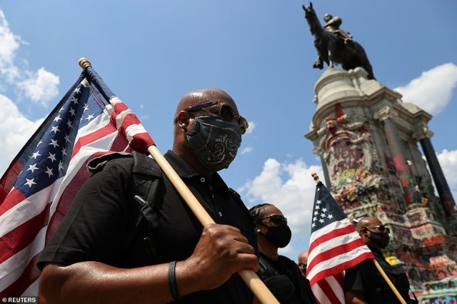 Protesters in Richmond, Virginia, gathered near the now-defaced Robert E. Lee statue on July 4. The Confederate monument was one of many that have been damaged since protests began in May