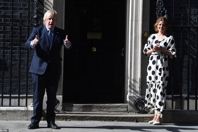 As part of the NHS birthday celebrations, Prime Minister, Boris Johnson and Annemarie Plas, founder of Clap For Our Carers, outside 10 Downing Street, London, join in the pause for applause to salute the NHS's 72nd birthday