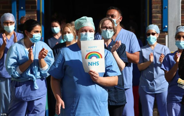 NHS staff outside the William Harvey Hospital in Ashford, Kent, join in the pause for applause to salute the NHS 72nd birthday