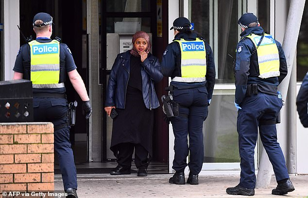 Since last Monday Victoria has detected 632 new patients, only 14 of whom are returned overseas travellers in hotel quarantine. Pictured: Police at a Melbourne housing estate